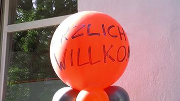 """Luftballon mit Aufschrift """"Herzlich Willkommen"""""""