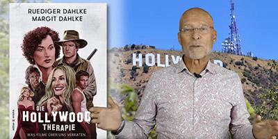 """Dr. Ruediger Dahlke mit dem Buchcover von """"Die Hollywood-Therapie"""""""