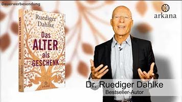 """Dr. Ruediger Dahlke mit seinem Buch """"Das Alter als Geschenk"""""""